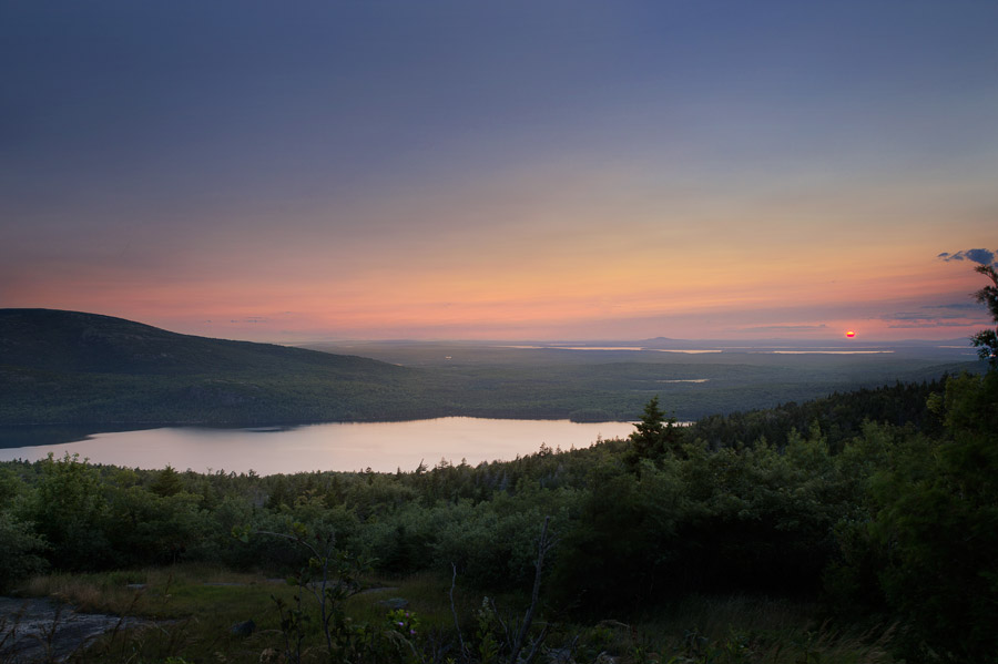 A sunset overlooking Eagle Pond and inland Maine. Eagle Pond is a very generous name for this massive lake. The view from Cadillac Mountain, 1530ft above sea level.