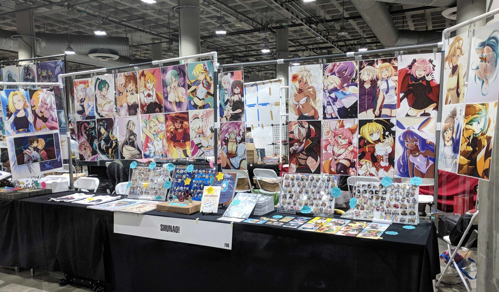 Anime Expo 2018 - Two and a half tables filled with merchandise ready to sell on the four day weekend. (1/2)