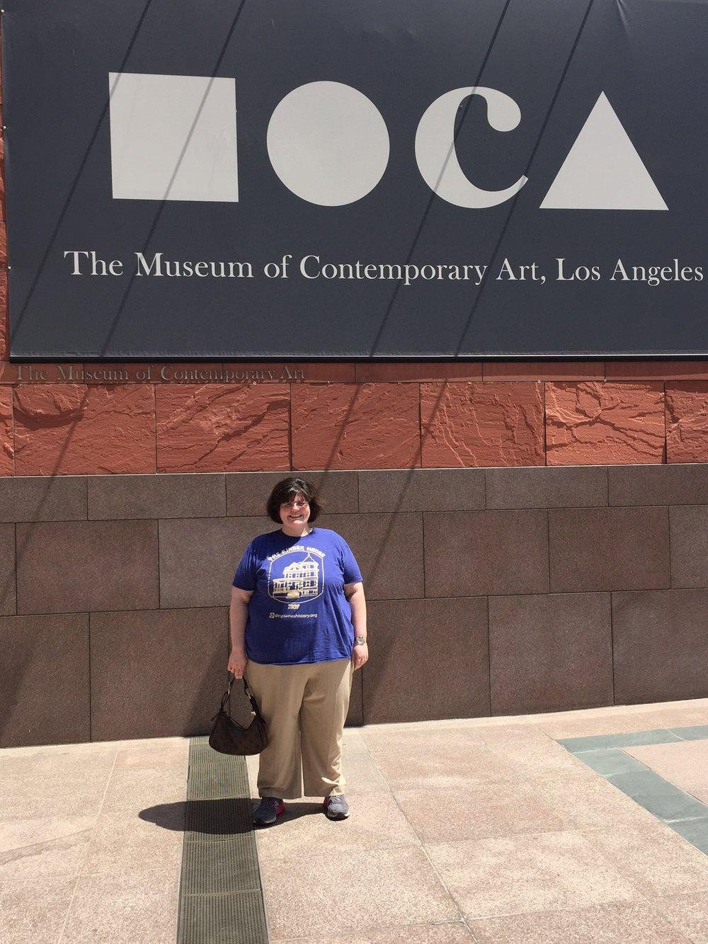 Des Plaines History Center employee Rachel Birkner visits Los Angeles to see some great art. She proudly dons her Kinder House tee shirt! August 13, 2017.