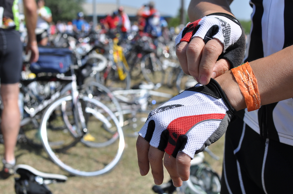 With 67 miles to the finish in Austin from La Grange, Allen starts out early and arrives at the lunch break at Bastrop. His gloves are very important when cycling; they provide much needed comfort and protection from calluses and blisters that can quickly develop without them.