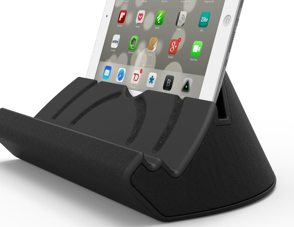 UPRIGHT While laying down, place your device in the upper channel to raise it for a more comfortable viewing angle. This Upright position also works well when placed on a desk or night stand.