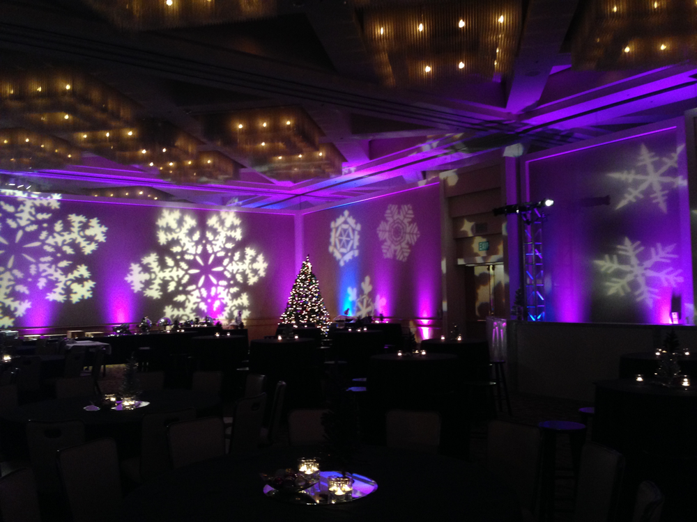 Snowflakes indoors! Helps make this christmas event feel more festive