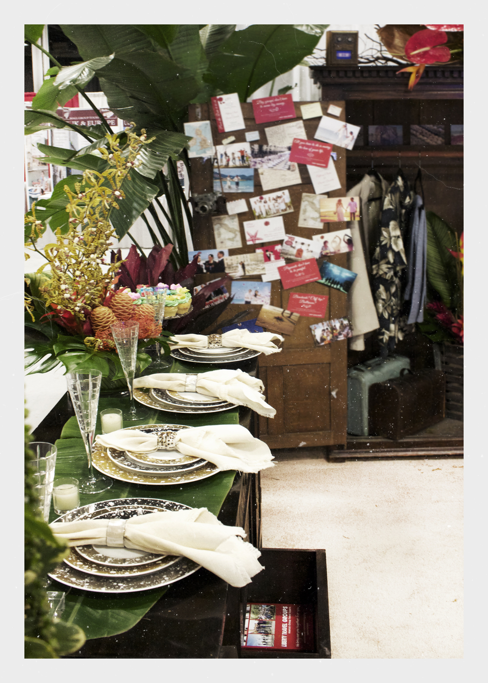 A bouquet of leopard orchids,alternating mother-of-pearl and natural shell napkin rings, and a five-foot wide banana leaf dressed the server for a destination wedding fit for a bride-to-be.