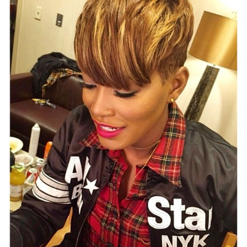 Keke Palmer getting ready backstage wearing Veronika Gold Dagger stud earrings.
