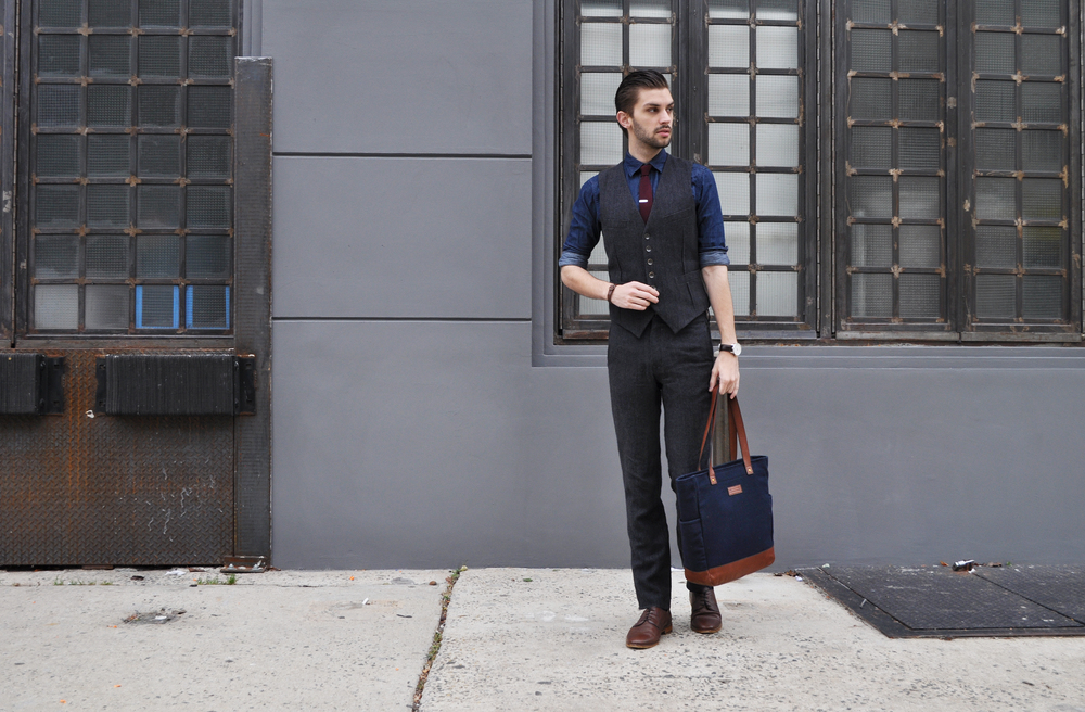 I have always loved Rag & Bone's style. They have classic casual pieces like tees, denim and sweatshirts, mixed with relaxed suiting and outerwear. It's Brooklyn meets Gramercy. I have had this 2/3 of a suit for years and while it may be dapper, the brass buttons and unlined pant give it a vintage, laid back feel. The young man's workwear. I'm a young man. And I work. So... there ya go. And I love the combination of a chambray or denim shirt with a suit. The mash-up of high and low is everything I'm about. Throw on a knit burgundy tie and your ready for the conference room or the bar. The darker suit, the darker the denim. Shop more Rag & Bone using the widget below! Rag & Bone (vintage...ish) suit / Uniqlo denim shirt / The Tie Bar tie and tie bar / Ben Minkoff bag (also vintage... ish) Banana Republic shoes / Will Leather goods bracelet
