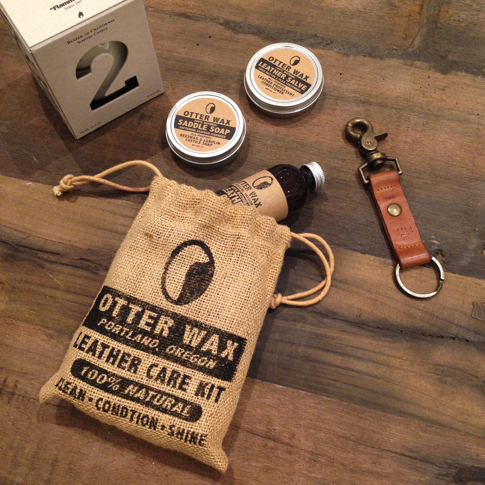5.   Otter Wax Leather Care Kit   - I'm an Otter. I couldn't resist including a little Otter Wax in my stocking. This Portland company has some great products to protect and maintain your leather through the Winter. It's perfect for guys who are really hard on their boots (like me). If you're investing a couple hundred on a pair meant to last a thousand miles, you need to look after them. Also sold in stores all over-- so check out their site for more dets.  6.   Will Leather Goods Key Fob   - We'll call this the West Coast part of the post. Will Leather Goods is based in Cali and all of their leather goods are Made in America. They make awesome bags, but you can never go wrong with a sturdy key ring. Everything is made to last and will better over time. It's a no-brainer.  7.   Baxter of California Candle   - Yes, they make candles for men. And they're bro-tastic (yeah, I went there). Baxter is a men's personal care company who makes some of the best smelling candles out there. They have two series: Wood and Ash. The Wood have clean scents that aren't floral like most candles. My favorite is Number 1, but all 3 are regulars in my apartment. The Ash Series smell exactly how they sound. Smoke Ash is like a camp fire in your apartment. It's a great gift for any man cave.