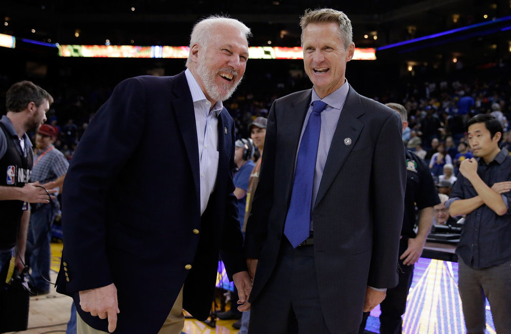 Popovich (L) and Kerr (R) share a lighthearted moment before a 2014 regular season game