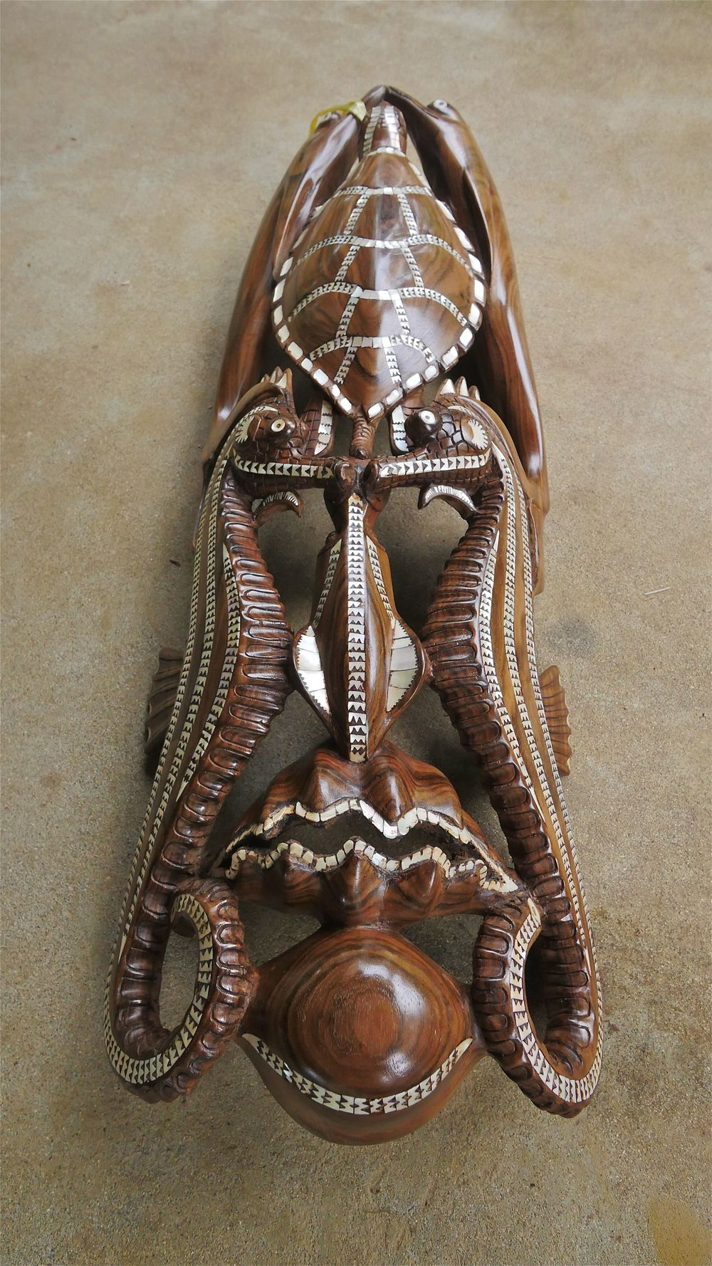 One of Maloe's artworks, made from local timber and nautilus shell. This mask represents the 'Spirit of Solomons' and is currently still for sale