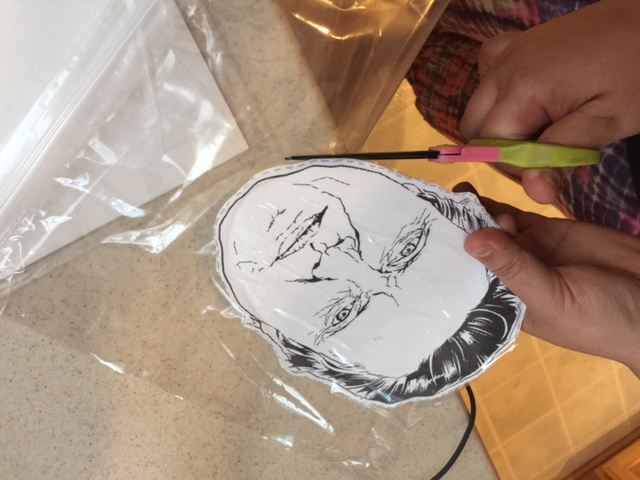 christopher walken mask cutting out from ziplock bag