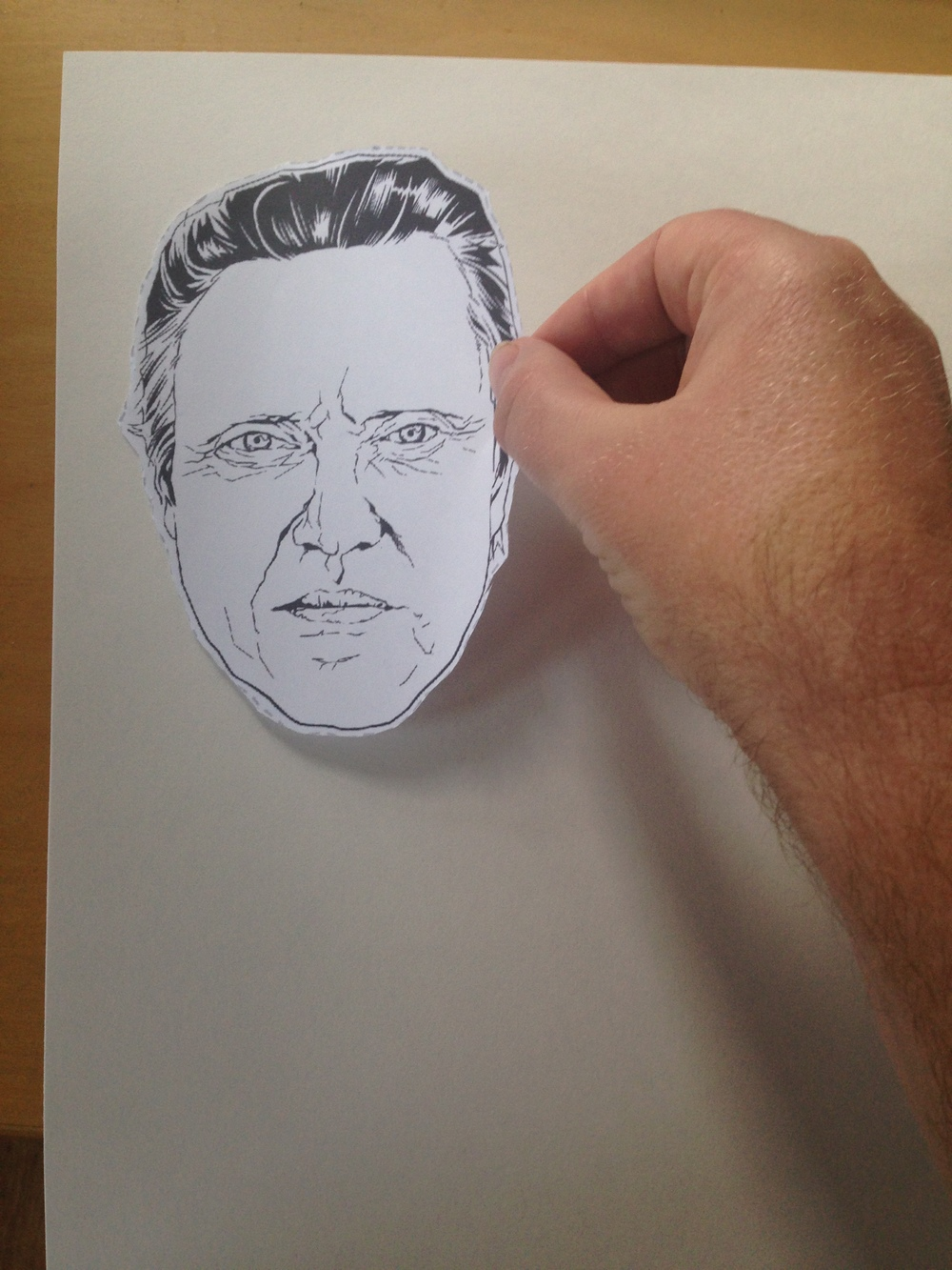 applying christopher walken mask to poster board