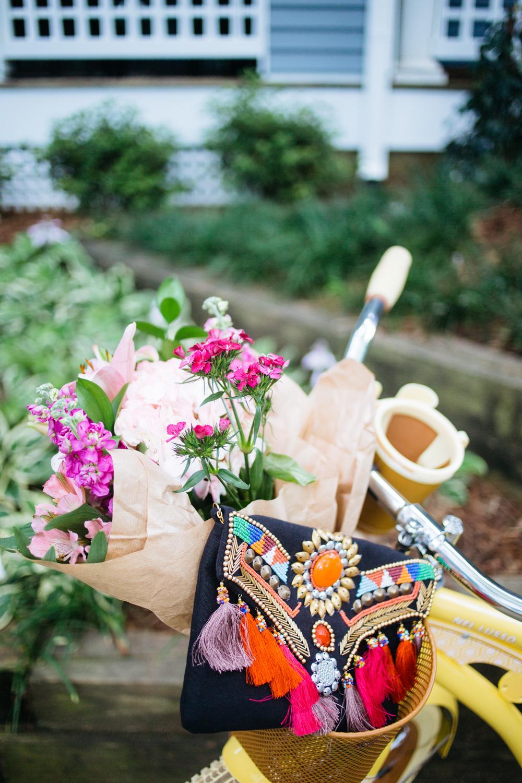 Tassel Clutch and Flowers in Bike Basket || @polishedclosets
