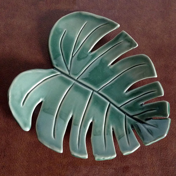 Monstera Leaf Ceramic Tray by Mama Coyote  For the plant lady or Golden Girls fan in your life. Seriously, have you ever seen anything more beautiful than this?!   Get it here .