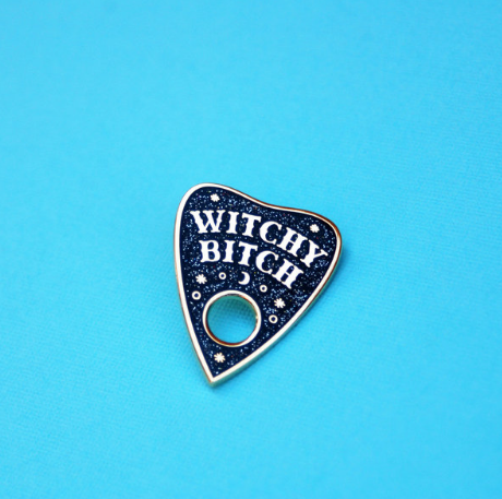 Witchy Bitch Ouija Planchette Pin by Bang-Up Betty  For the witchy woman on your list. This gift is Krampus-approved.   Get it here.