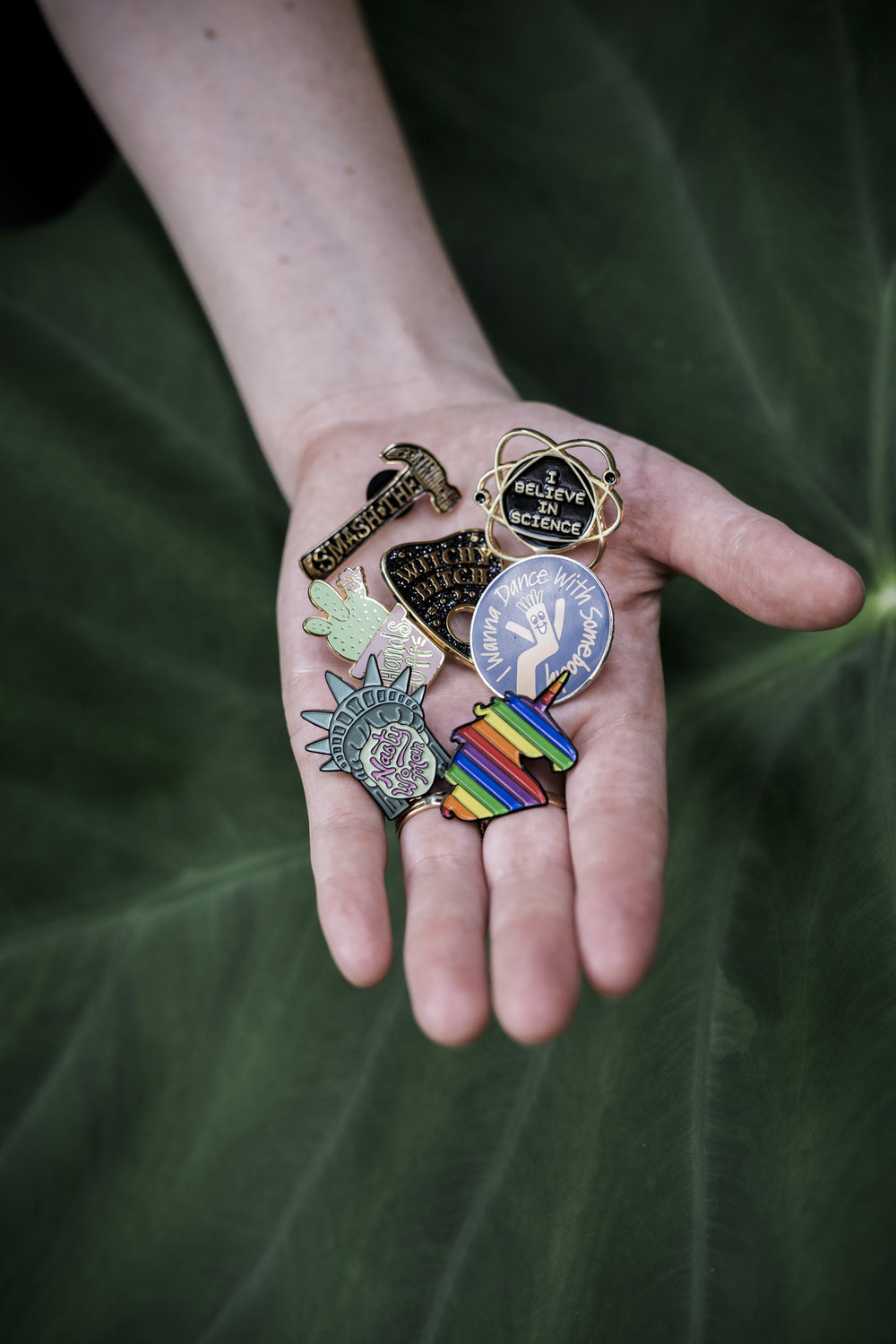 Nasty Woman, Smash the Patriarchy, I Wanna Dance with Somebody, Hands Off, Witchy Bitch, I Believe in Science... these are few enamel lapel pins created Bang-Up Betty in Arkansas.