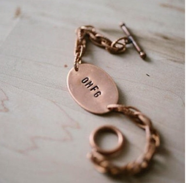 One of the first Bang-Up Betty jewelry designs, a handmade stamped copper bracelet, called the four-letter-word bracelet. You could order customs! You still can in my  brass or silver mantra bracelet.  Photo by Arshia Khan.