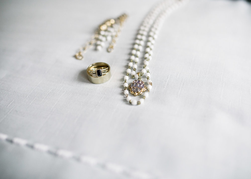 I built an elegant and vibrant Czech glass chain in graduated layers to frame this beautiful little amethyst, diamond and gold charm that belonged to my Grandmother. I was sure that I wanted to wear something of hers on my wedding day.