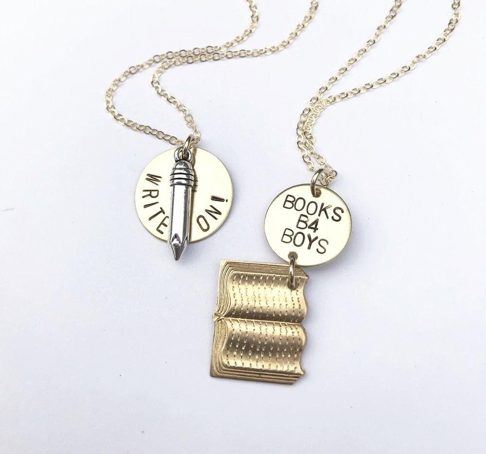 Write On! and Books B4 Boys, two witty literary necklaces designed by Bang-Up Betty for Et Alia Press, a Little Rock-based independent publisher.