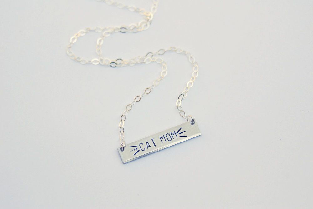 This  Cat Mom Necklace  with adorable stamped whiskers is the purrrrrfect gift for cat lovers.