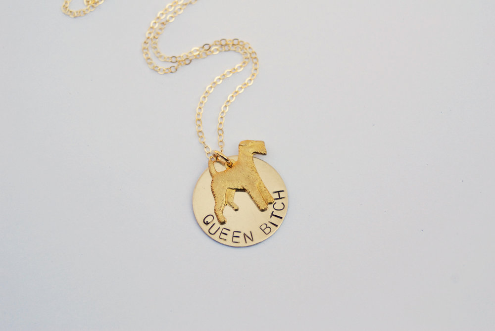 Because you're top dog around here. This  Queen Bitch Necklace  has a solid brass, textured dog charm in the sassiest pose.