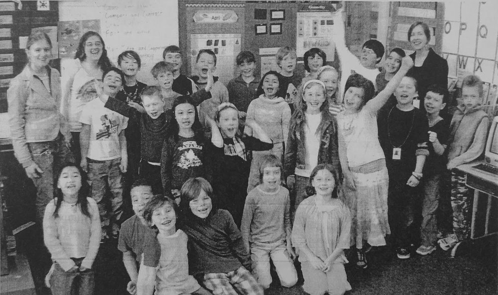Lewis Elementary class with Reedie outreach teachers Casey Hurstell and Katherine Loera; this picture accompanied the class' letters asking for further funding for Biology Outreach to continue in 2008. Courtesy of Special Collections, Eric V. Hauser Memorial Library, Reed College