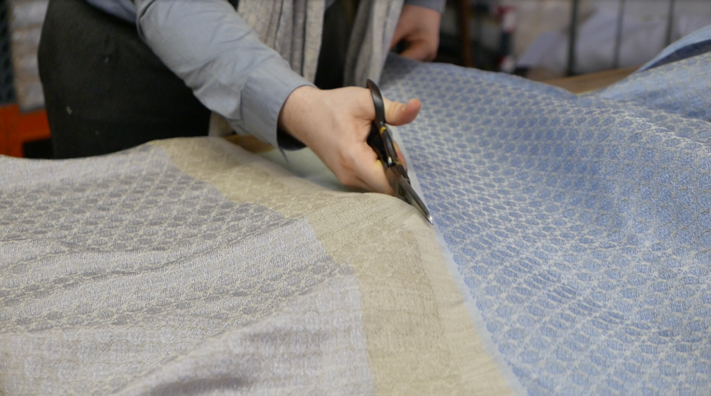 Brendan Joseph cuts loom-state silk and linen shawls from his 'Edge of the World' collection.
