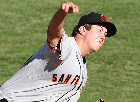 Derek Law throws for the Scottsdale Scorpions in 2013's Arizona Fall League. (Sam Dykstra / MLB)