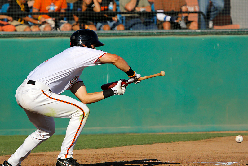 Jarrett Parker lays down a bunt back in 2012 for the San jose Giants. (Conner Penfold / Giant Potential)