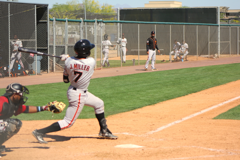 Jalen Miller swings and clubs his first professional home run during minor league spring training, March 26 in Scottsdale, Ariz. (Conner Penfold/Giant Potential)