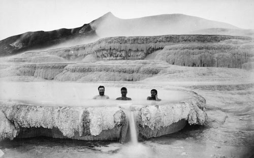 Here three men (one  Pākehā  and two Māori) share a bath at the White Terrace, about 1880.  Source