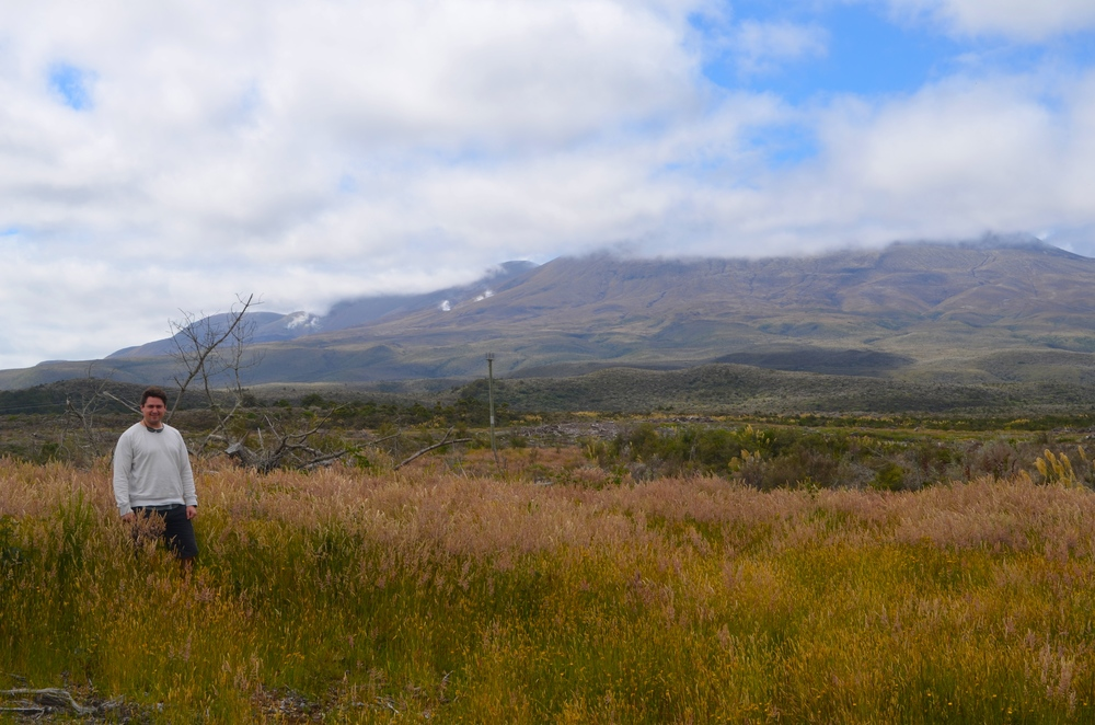 Standing in Tongariro National Park with Mt. Raupehu in the distance.
