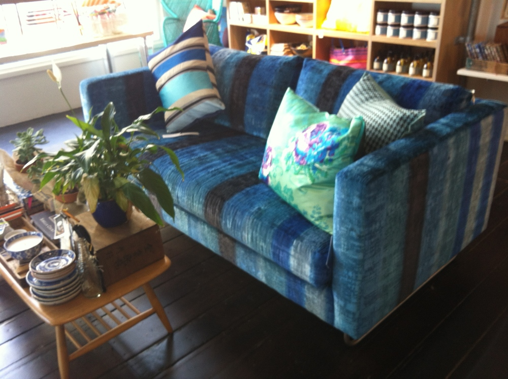 I want this funky blue velvet couch in my living room.