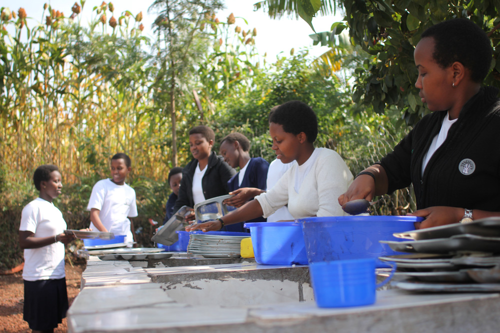 Students at the school, washing dishes