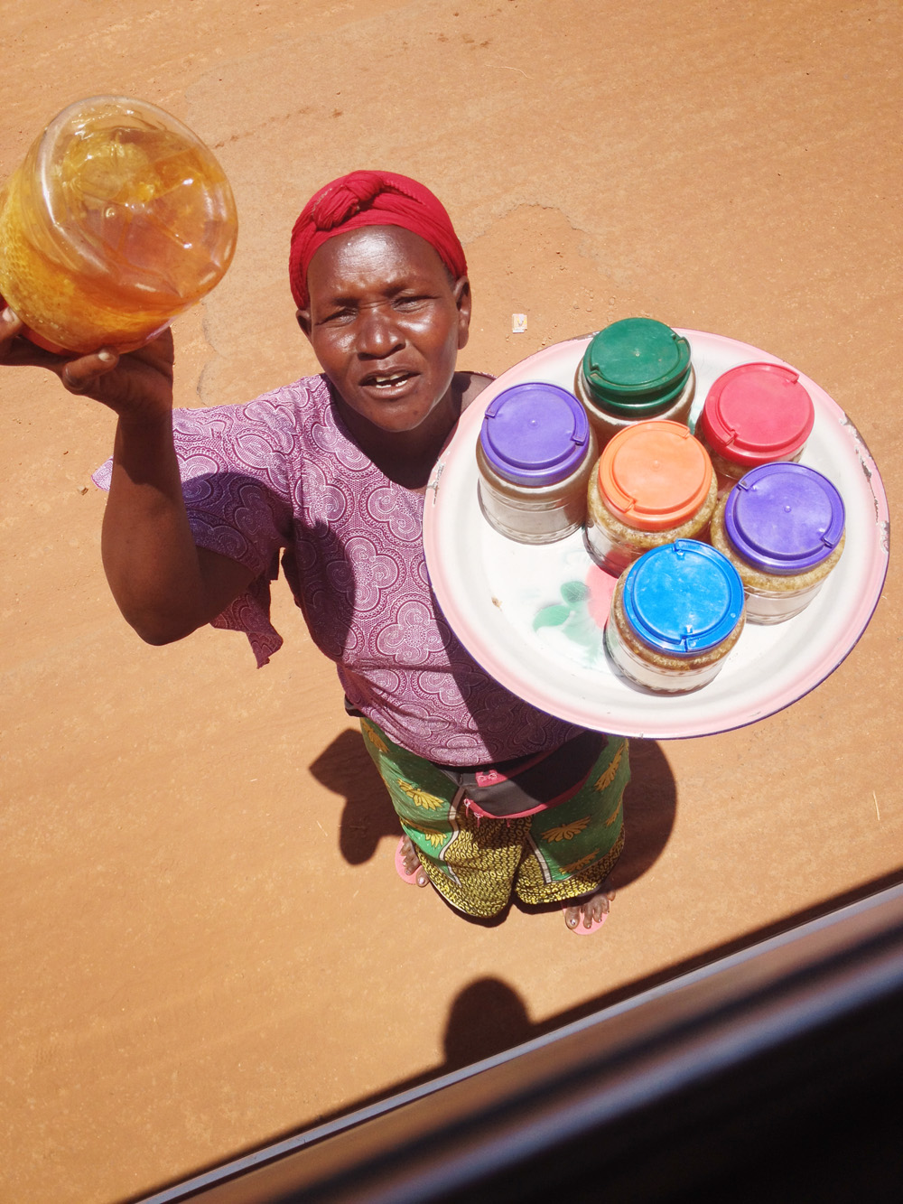 Selling honey in Uganda