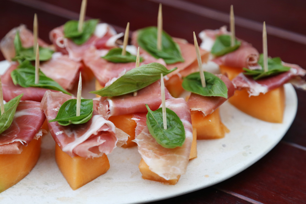 cantaloupe, proscuitto, and basil appetizer