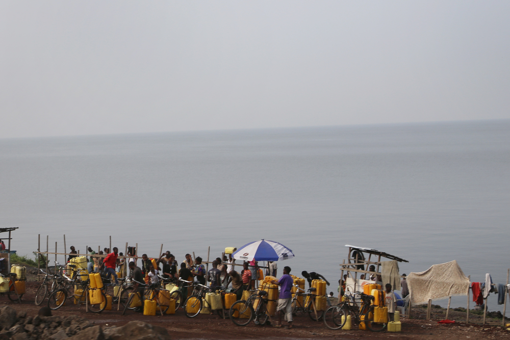 Residents collecting water at the shores of Lake Kivu