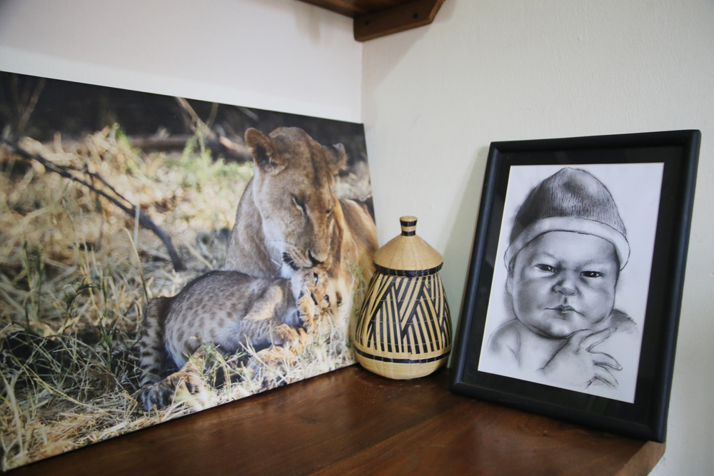 Photo by  Sherry McKelvie Wildlife Photography .  Caricature drawing by local artist Johnmary Mukisa.  Basket from Rwanda.