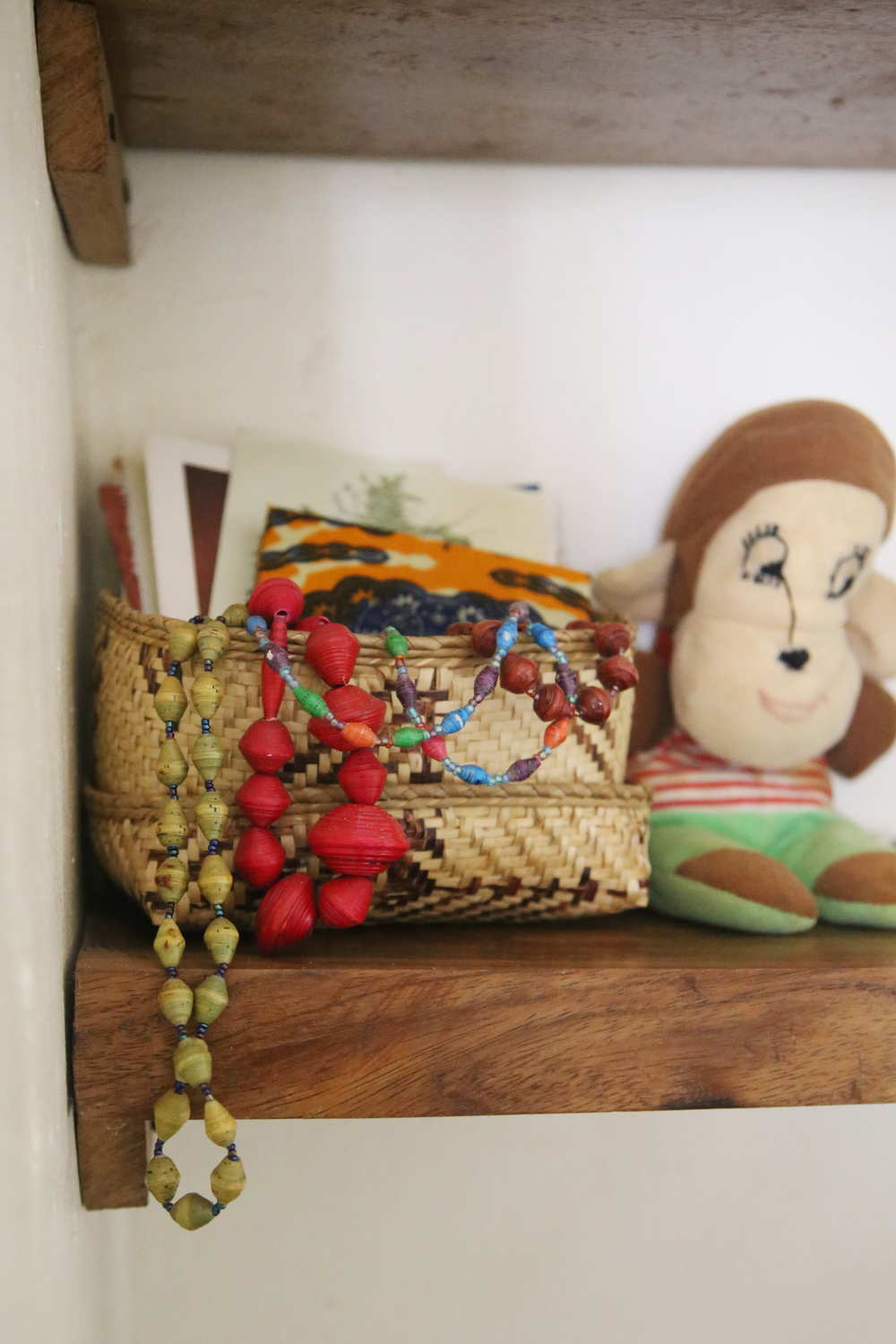 Beads given to me by women at my birthing blessingway. Basket made locally.  Stuffed monkey was Eric's when he was a baby.