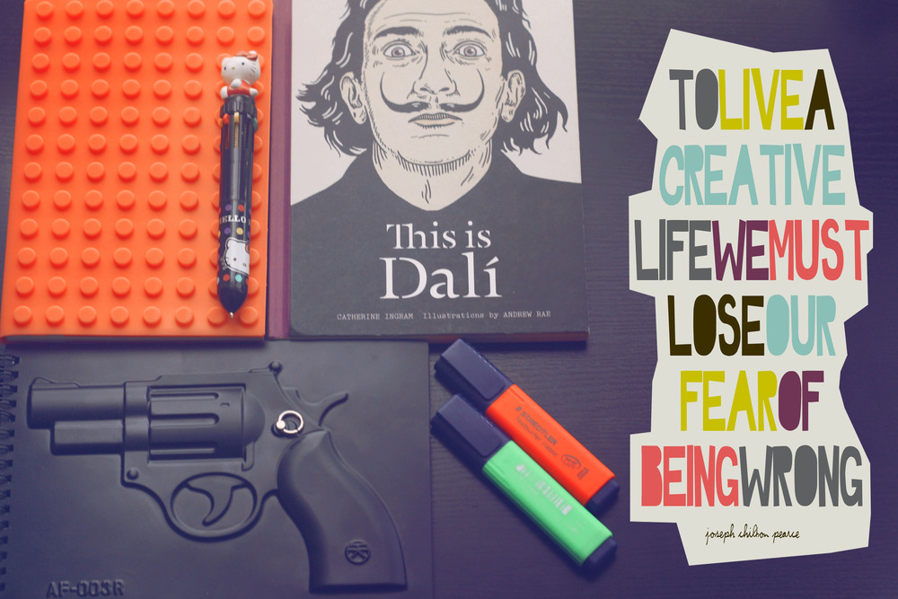 "My work desk essentials : ""bitch don't kill my vibe"" notepad, must have Hello Kitty pen and the Salvador Dalí book I draw inspiration from. ""Every morning upon awakening I experience a supreme pleasure: that of being Salvador Dalí, and I ask myself, wonderstruck, what prodigious thing will he do today, this Salvador Dalí."""