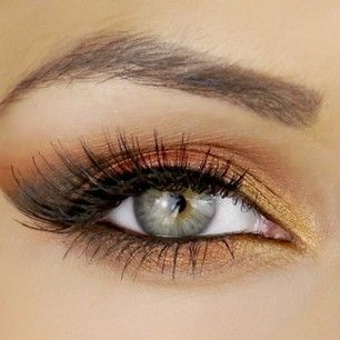 Here I used the Orange tone all over the lid, avoiding the inner corner. I mixed the Gold and Champagne tones for the inner corner of the eyes to brighten the eye area. A black eyeliner was used along the lash line to add definition, this stops the coppery tones from making the eyes look a bit, well sore! and I applied false lashes for added length.