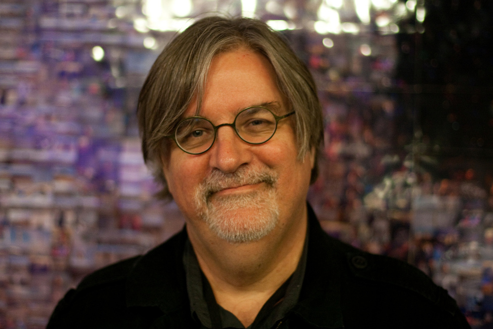 Creator of The Simpsons Matt Groening in front of the Iggy Pop mosaic.