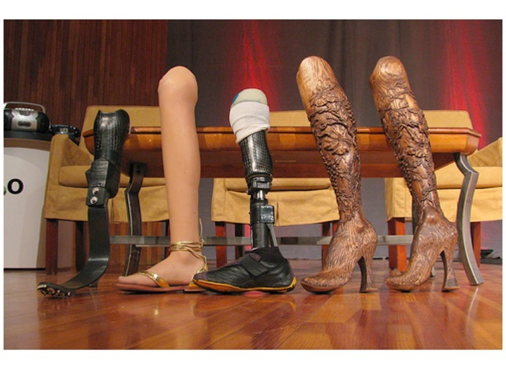 A few of Aimee Mullins' prosthetic legs, including some stunningly beautiful carved wooden legs