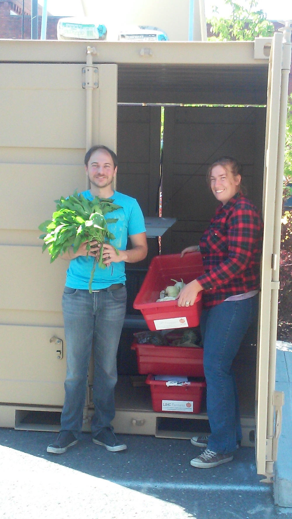 Joel and I dropping produce at the Toolbox!