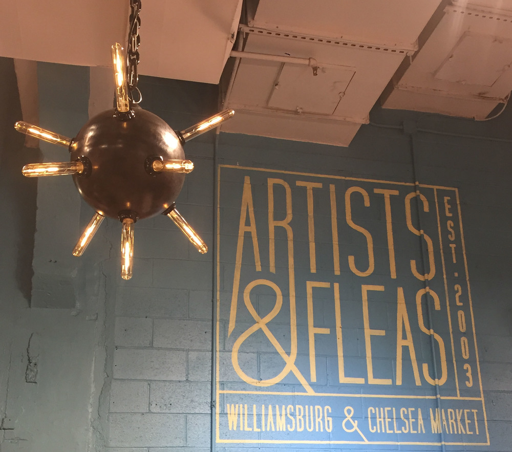"Made from a 12"" diameter mild steel ball, we finish the piece with our signature black patina and paste wax. The chandelier is paired with nine 2 watt LED beacon bulbs, so the entire light is just 18 watts!"