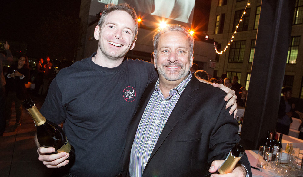 We do fashion too: Owner Thomas Preti with a staff member wearing a t-shirt logo we designed.