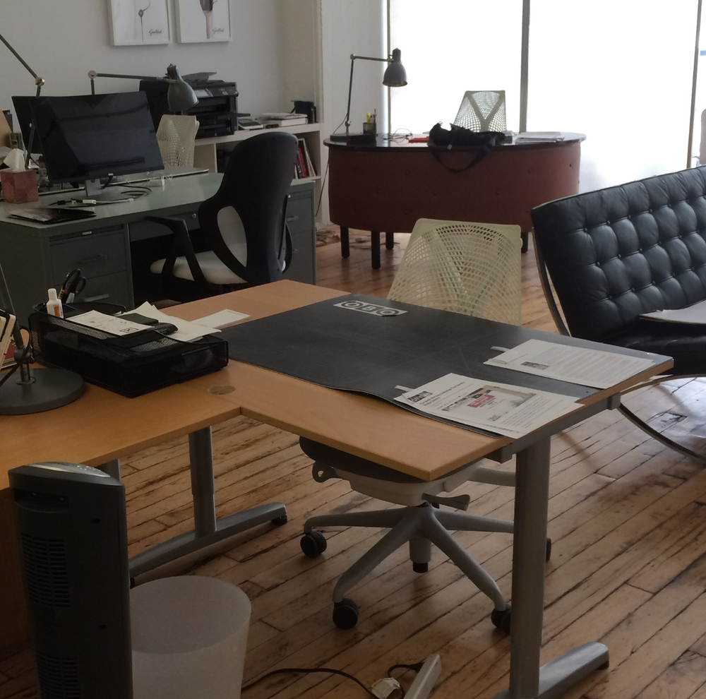 Open Studio Desk - $550 a month Includes - Studio desk space with storage tray and chair,  kitchen,  printer availability, monitor if needed & stationary. Trash disposal. Access to private conference rooms in building with whiteboard. Access to private phone booth,  shared couch spaces and kitchen.