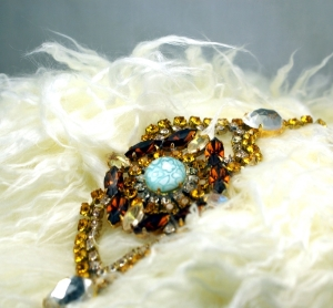 Bohemian Czech Topaz & Gold Rhinestones, Aqua flower under glass dome center. Lace camisole with tobacco leather jacket.