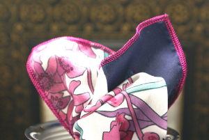 Magenta contrast stitched edges. Add this floral to a dark navy suit, or white linen jacket.