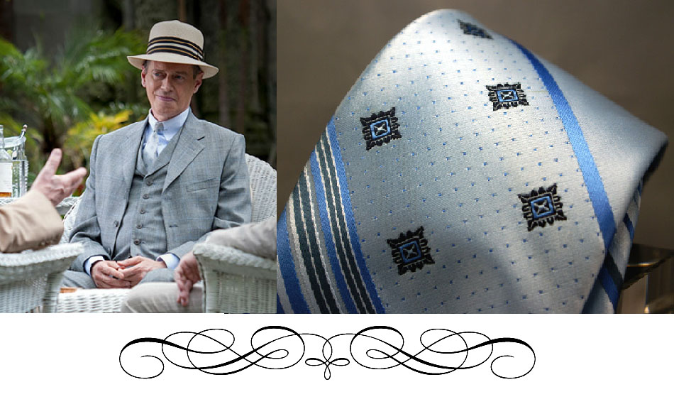 Nucky ain't afraid of pastel colors. Baby blue plaid suit with a tone on tone tie and of course, to complete the look....always........the collar bar.  http://www.hbo.com/boardwalk-empire