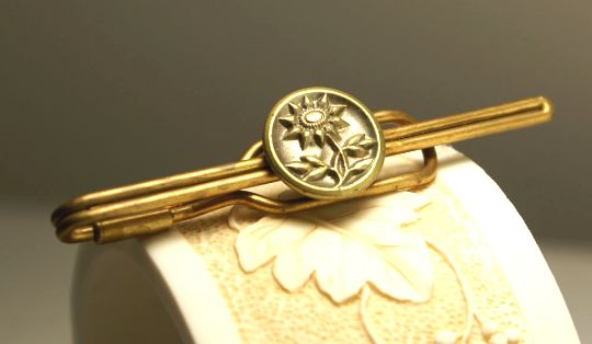 Beautiful Antique sunflower design made in brass added as an embellishment to a brass tie bar
