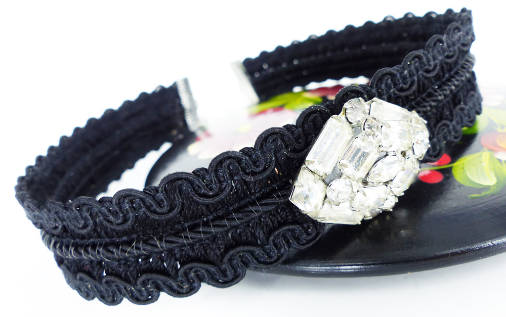 This is from our new choker collection: Woven classic black with attached clear rhinestone crystal embellishment